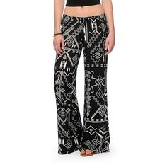 Made with a tribal print design for a boho-chic look, this relaxed fit pants are constructed with a lightweight woven rayon material for a comfortable wear perfect for the beach.