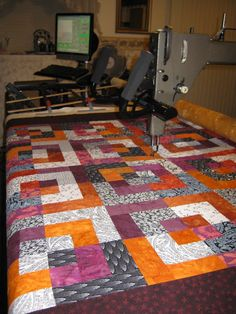 "This quilt is called Bento Box which means ""Lunch Box"" in Japanese. It is made up of Orange, Purple, Black and White fabric. The stitch is..."