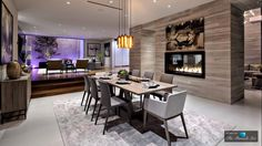 Open plan dining room has its own zone with a fireplace