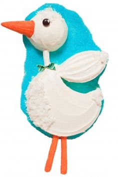 Stork cake: fluffy feathers made from shredded coconut and the beak from an ice cream cone.