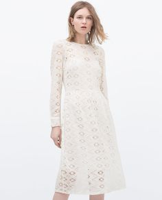 Ladylike, elegant, white. All three = perfection. Pair with nude sandals or a pointed low heel. Minimal jewelry, as the eyelet detail takes this white dress to the next level.