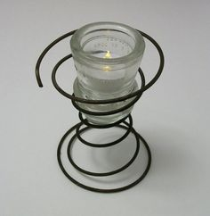 tea light holder made of old insulator and rusty coil spring