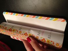 Edge pages of planner with washi tape