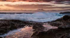 Fire in the sky during this Sunrise shoot at Maroubra Rock pools in New South Wales, Australia. I am glad that I chose to be the photographer on this day rather than swimming as the water was plagues with Blue Bottle Jelly Fish.