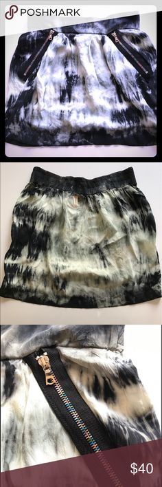 Gypsy 05 Jewel Silk Zipper Mini Skirt. NWOT This is a perfect addition to any fashionistas wardrobe. This skirt cones in a beautiful black/white/grey tie-dye pattern. It features cool zippers as trim for the pockets and an elastic waistband for comfort. 100 % silk. Dry Clean Only. Eco-Frienly dye processes and materials. Made in Hollywood, CA, USA Gypsy 05 Skirts Mini