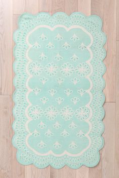 Plum & Bow Scalloped Eyelet Rug, Urban Outfitters.  The description says it's 4'x6', but the selections say 3'x5'. Either way, it doesn't seem too bad for the price. I really like this type of blue-green, and I like the scalloping - very cute! Supremely magical.