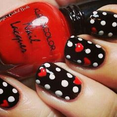Polka dotted nails reminds me of minney mouse