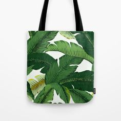 Banana Leaves Tote by Huntleigh Our quality crafted Tote Bags are hand sewn in America using durable, yet lightweight, poly poplin fabric. All seams and stress points are double stitched for durability. They are washable and feature a sturdy 1 wide cotton webbing black strap for comfortably carrying over your shoulder. Choose from 13x13, 16x16, or 18x18