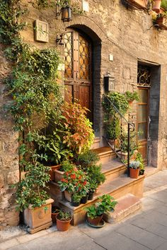 Beautiful doorway in the medieval village of Assisi, Italy