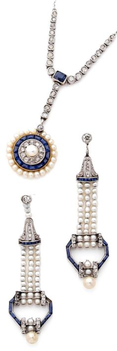 AN ART DECO DIAMOND, NATURAL PEARL, SAPPHIRE, PLATINUM AND GOLD DEMI PARURE, CIRCA 1925. Comprising a necklace and a pair of earrings. #ArtDeco #earrings #necklace