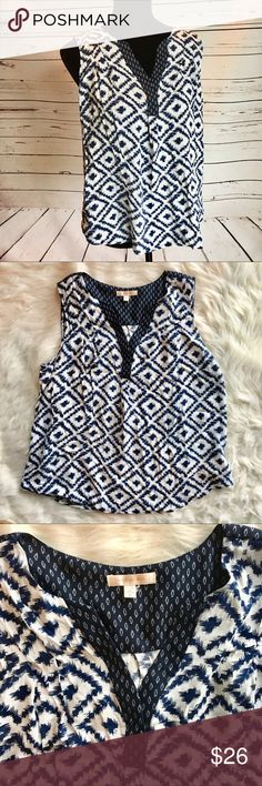 Skies are Blue XL Stitch Fix sleeveless tank top Cute navy blue and white Stitch Fix top. Size XL. Sleeveless style tank with flowy fabric. Gently worn with no major flaws. Geometric pattern with contrasting trim on the split v neck. Skies Are Blue Tops Tank Tops