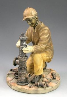 Tradesman Series Plumbing Engineer  Handcrafted with lots of detail, with nuts bolts and various tools lying around   Approximately 168mm tall and 127mm across  Supplied in a tradesman themed gift box