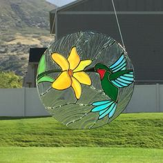 Stained glass hummingbird and flower suncatcher, glass hummingbird, orange flower by FoxStainedGlass on Etsy