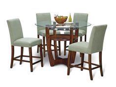 This 5-piece package includes a 48 round Counter-Height Table and four upholstered Stools. A perfect marriage of glass, wood and metal. These three design elements meld to create a contemporary style. Legs are all-wood. Stools are upholstered for amazing comfort. Stools also available in other colors. View our wide assortment of Aclove Dining Pieces online or visit a store close to home