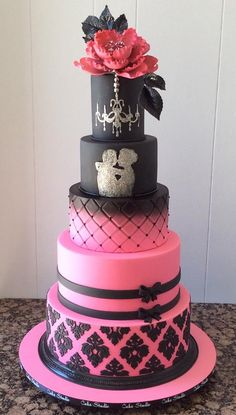 A stunning pink and black cake by Cake Studio made with our Damask Pattern Silicone Onlay and Vintage Bow.