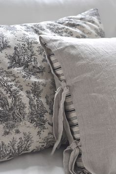 Toile and ticking cushions