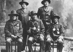 Standing L-R: Joe Healy, Running Crane Sitting L-R: Blackfoot Old Woman, Day Chief, Crop Eared Wolf - Blackfoot (Kainai) - 1905