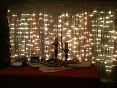 Curtain lights installed behind sheers are wonderful behind a buffet table. Use cup hooks to install them. Allows you to put them up just for parties or Christmas. Drop Cloth Curtains, White Curtains, Hanging Curtains, Lantern String Lights, Icicle Lights, Starry Lights, Cheap Christmas Lights, Christmas Decor, Christmas Ideas