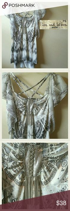 NWOT! Live and Let Live Heavy Metal Blouse Never worn. Ever. Perfect condition. No flaws!! 100% Poly It might as well be NWT because the plastic from the tag is still attached. This is some of the softest Poly you'll ever experience. It's embellished with metal. So cool. See pics 1 & 2. So super trendy and strappy. The front has criss- cross straps. Pr. W/ a black super strappy bandeau. Cute! It's pretty long. Great with leggings too. Or shorts! Jeans...haha! So flowy. This company plays off…