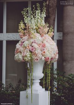 Stunning Wedding Aisle Arrangement of Pink,  White and Peach Flowers.