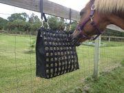 THE NIBBLENET ® PICNIC PLUS slow feeding hay bag.