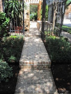 High function in a small side yard! Pergola, patio, raised bed, fountain, etc. Ravenscourt Landscaping and Design LLC The residents of thi...