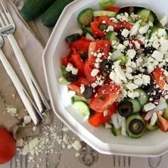 Shopska salad: Bulgarian salad of tomatoes, cucumber, roasted peppers, olives and sheep's cheese. Shopska Salad, Olives, Cucumbers And Onions, European Cuisine, Bulgarian Recipes, Hot Soup, Exotic Food, Weird Food, Roasted Peppers