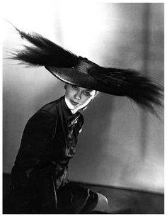 Lud Modelling a Schiaparelli hat, photo by Horst, Paris, 1946
