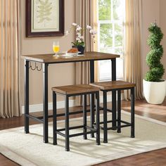 Maximize your space with a 3-Pc. Metal and Wood Pub Set by Linon Home Decor Products. The stools tuck neatly under the pub table when not in use, making this set perfect for small dining rooms or kitchen breakfast nooks. Hooks along the side of the table can be used to keep linens and towels within easy reach. With its clean lines and planked detail, this pub set adds rustic charm and stylish function to your home.