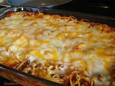 Spaghetti Pie  Filling: 3 eggs, beaten 1 cup sour cream 1/2 cup Parmesan Cheese 1 cup Mozzarella Cheese 1 lb Spaghetti Noodles, cooked and cooled  Mix eggs, sour cream and cheeses well. Toss in noodles. Place in a greased 13X9 casserole dish.  Sauce: 1 1/2 lbs Ground Chuck, seasoned with salt, pepper and garlic powder, browned and drained 1 - 24oz can Spaghetti Sauce, your choice 1 - 12oz can diced tomatoes, drained 1/2 tsp basil 1/4 tsp oregano salt, pepper and garlic powder, to taste…