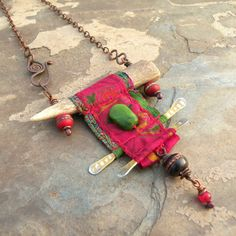 Idea - necklace. interesting with felt or rich fabric/ tapestry. - Necklace.A one of a kind, long, bohemian statement necklace with a nomadic style, reminiscent of prayer flags or an ancient scroll..