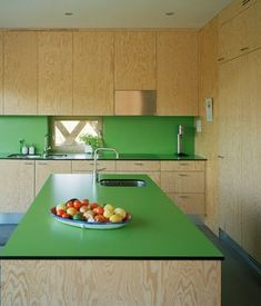 Another way to use laminate in kitchen, the green laminate by Abet Laminati