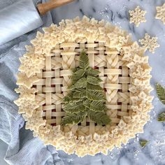 Bicolor green pine tree needles Christmas pie with butter woven strip and braid crust and snowflake trim Christmas Goodies, Christmas Treats, Christmas Pies, Christmas Cross, Christmas Decorations, Holiday Baking, Christmas Baking, Beautiful Pie Crusts, Pie Crust Designs