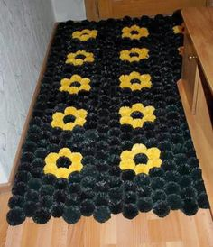 Mat pompons, which are made of garbage bags.