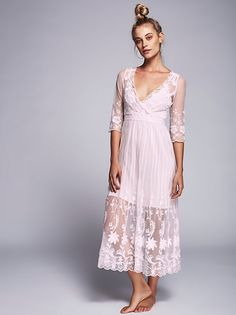 Friends Forever Dress | Beautiful and ethereal sheer mesh maxi dress featuring floral embroidery detailing and a pleated skirt. Surplice V-neck with scalloped trim and three-quarter length sleeves. Lined.