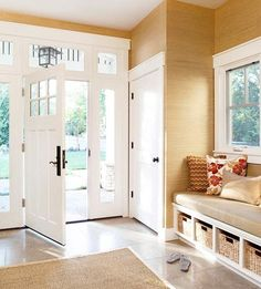 Built in bench in entryway. Love the windows around the foot. Natural light in entryway. Storage Bench Seating, Built In Seating, Built In Bench, Entryway Storage, Entryway Organization, Storage Baskets, Entryway Closet, Shoe Storage, Narrow Entryway