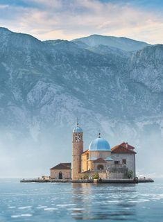 Our Lady of the Rocks, Perast, Montenegro. An artificial island created by bulwark of rocks and by sinking old and seized ships loaded with rocks. The islet was made over centuries by local seaman who kept an ancient oath after finding the icon of Madonna