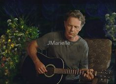 """Bruce Greenwood Plays Guitar  Bruce Greenwood playing guitar on a summer evening. Inspired by the film """"And Now a Word From Our Sponsor.""""  This was a touching and very beautiful piece of music in this film. I have to say that if I had a neighbor who sat out on his terrace and played such beautiful music that I would leave my windows open all night to listen to him play. This scene will truly touch your heart and soul and stay with you for a long time."""