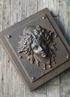 Luna is an antique reproduction of a classical architectural detail . She makes a great paperweight or can also hang on the wall, hand cast and finished to look like weathered cast iron. By Cast Shadows Studio on Etsy