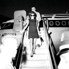 Jacqueline Kennedy Onassis arriving at JFK airport, back from a weekend trip in Skorpios, c. 1969.