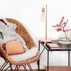 tifmys – Rattan chair: Vintage | Fur: Ikea | Bag: A.P.C. Half-moon | Copper lamp: Urbanara | Square table: Maison du Monde | Vase: H&M Home with Illex