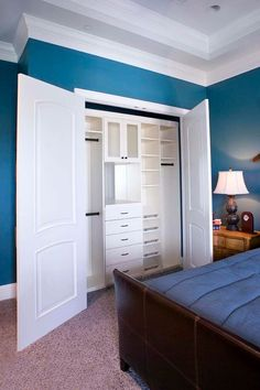This bright and cheery reach-in closet provides wonderful storage solutions for any bedroom. With three hanger areas, fives drawers and multiple shelves, this closet is effective and functional for a smaller space. Bedroom Closet Storage, Bedroom Closet Design, Master Bedroom Closet, Closet Designs, Diy Bedroom, Bedroom Closets, Closet Shelves, Blue Bedroom, Bedroom Ideas