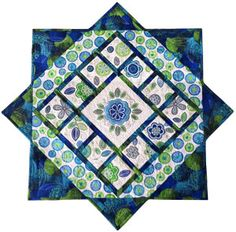 Beautiful square table topper design (shown with machine embroidery).  Free downloadable pattern. source:  WeAllSew.com