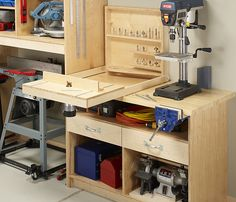 Nice router bit holder with flip down router table and fence.