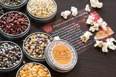 "Say ""Happy Father's Day"" with our deluxe popcorn and popcorn seasonings gift assortment. This gift box holds a set of 16 tins: Eight (8) tins of our delicious non-GMO popcorn kernels and eight (8) tins of popcorn seasonings. Each tin of popcorn kernels holds enough to make one big bowl of popcorn - and the seasoning tins hold enough for several more. By Dell Cove Spice Co., in Chicago, Illinois http://www.dellcovespices.com"