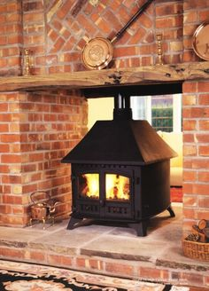 woodburner in stone inglenook style fireplace Double Sided Stove, Double Sided Fireplace, Inglenook Fireplace, Stove Fireplace, Fireplace Ideas, Basement Workout Room, Ranch Decor, Log Burner, Home Accents