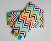Red Charlotte sucking pads for baby carriers. Also called teething pads, drool pads, or chew pads. Fits the Ergo, Mei Tai, BabyHawk, Beco, Boba, Kinderpack, Baby Bjorn, Pikkolo, Patapum, Bamberoo and more. #babywearing, #ap, #attachmentparenting, chevron fabric, zig zag