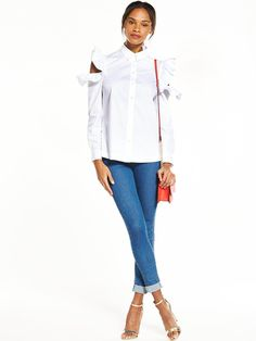 V by Very Cold Shoulder Shirt Putting a feminine spin on a masculine classic this V by Very shirt takes romantic ruffles from the SS17 runways and a summer-ready cold shoulder trend to new levels of smart! In white it's super fresh too and perfect for adding flirty vibes to your 9-5 or smartening up your off-duty denim. Styling Ideas We love our model's pared back look in turn up hem skinny jeans, metallic sandals and a red crossbody bag for a cute colour pop!