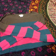 Urban Outfitters colorful top Colorful top from Urban Outfitters. Crocheted gray look on top and block colors on the rest. Thin sweater material, very comfy. The back rests slightly lower than the front. Great condition! Urban Outfitters Tops