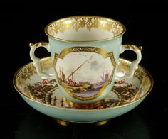 Meissen two handled cup & saucer.